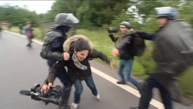 Police forces pushed and hit journalists with batons while dispersing a protest against a proposed labour law in Rennes, France, June 2016